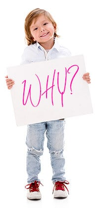 Holding a Why sign in the Why Game